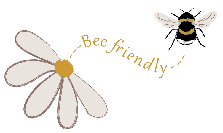 flower with 'Bee friendly' text curving toward a black/white/yellow bumblebee. Bee Friendly. ©2020 Outspoken Images by Marie Warner Preston