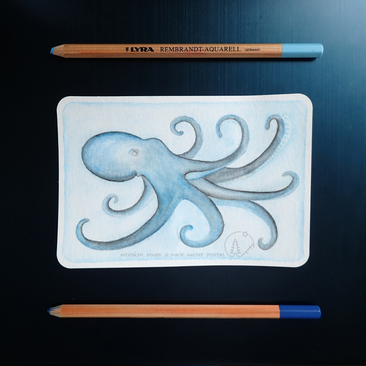 watercolour painting of blue octopus on blue background with blue watercolour pencils.