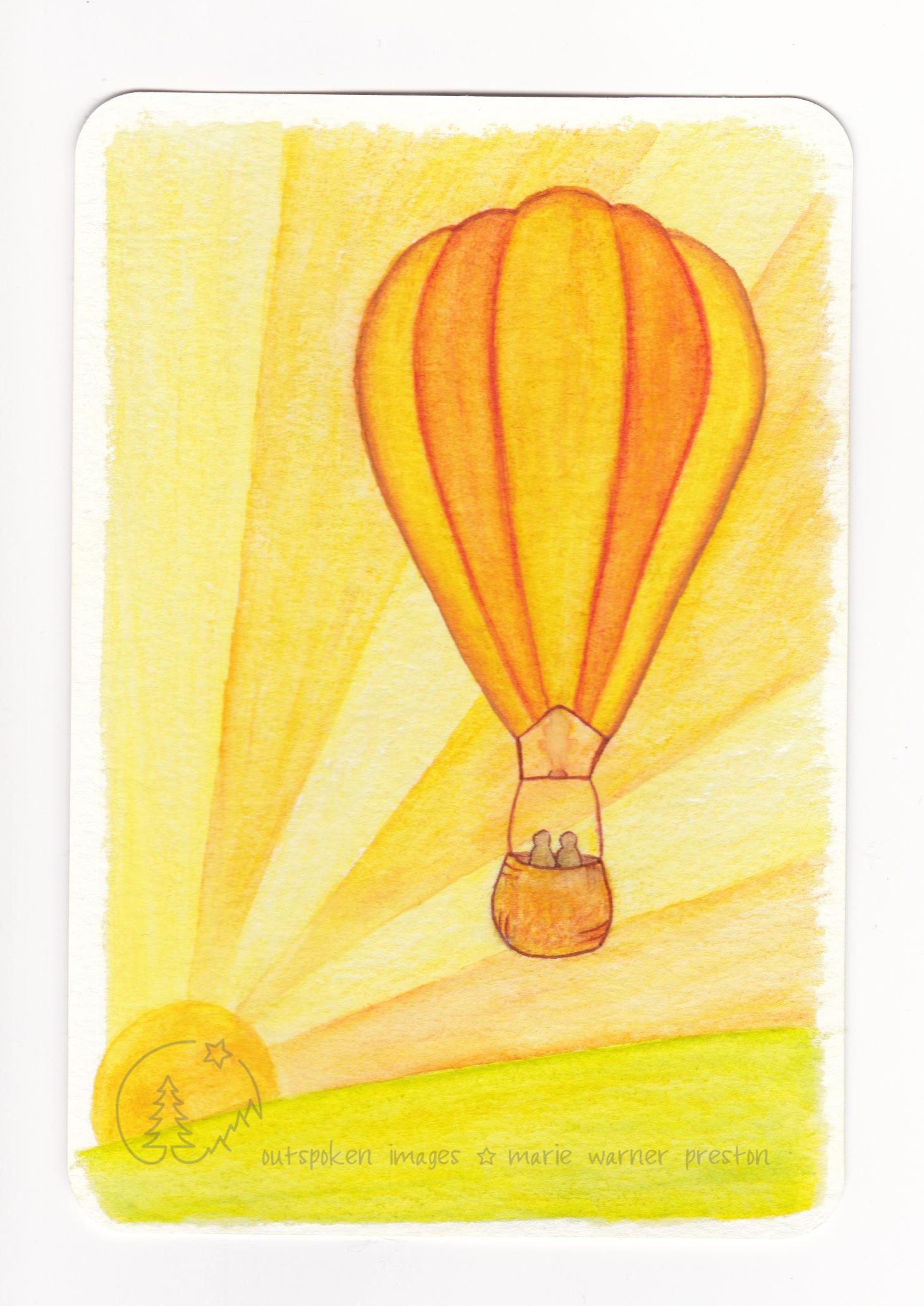 orange hot air balloon against orange sun rays. Orange Arrival. ©2021 Outspoken Images by Marie Warner Preston